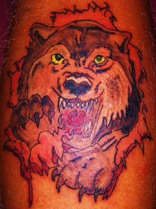 Red angry wolf with yellow eyes tattoo for Red wolf tattoo