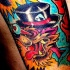 Bright and colorful cartoon wolf tattoo